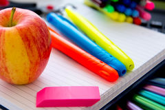Back to school supplies and an apple for the teacher Stock Images