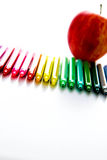 Back to school supplies and an apple for the teacher. Bright colored back to school supplies and an apple for the teacher Stock Photography