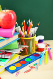 Back to school supplies. Books and blackboard. Royalty Free Stock Photography