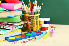 Back to school supplies. Books and blackboard Royalty Free Stock Images