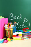 Back to school supplies. Books and blackboard. Royalty Free Stock Images