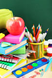Back to school supplies. Books and blackboard. Stock Images