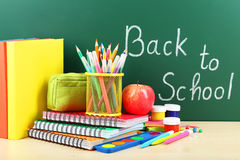 Back to school supplies. Books and blackboard. Royalty Free Stock Image