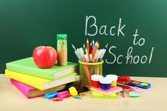 Back to school supplies. Books and blackboard. Stock Photos