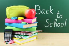 Back to school supplies. Books and blackboard. Stock Photo