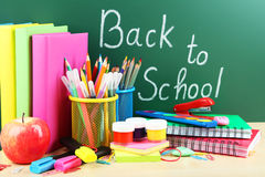 Back to school supplies. Books and blackboard Royalty Free Stock Photo