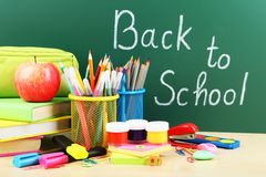 Back to school supplies. Books and blackboard Stock Images