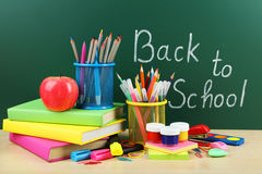 Back to school supplies. Books and blackboard. close up Stock Photos