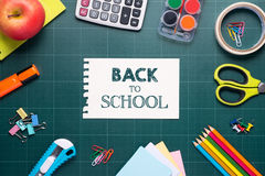 Back to school supplies. Books and chalkboard. Royalty Free Stock Images