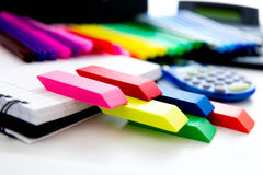 Back to school supplies, bright colored  markers, paper erasers Stock Images
