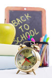 Back to school supplies with clock Stock Image