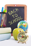 Back to school supplies with clock Royalty Free Stock Photos