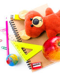 Back to school supplies with Notebook and bear toy on white  bac Stock Photography