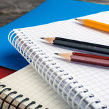 Back to School, supplies, notebook on the grey background. squar Royalty Free Stock Photography