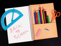Back to school supplies on notepad Royalty Free Stock Image