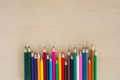 Back to school supplies, stationery colorful pencils accessories wooden background, Top view flat Stock Images