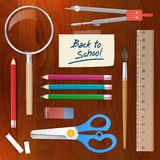 Back to school supplies tools on wood background Stock Images