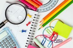 Back to School: School Supplies on a White Desk royalty free stock image