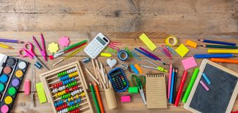 Back to school. School supplies on wooden background, top view royalty free stock photos