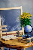 Table for school classroom, the chalkboard, a globe and open book, round table. Back to school. table for school classroom, the chalkboard, a globe and open book royalty free stock photography