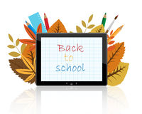 Back to school on tablet. Computer tablet with autumn leaves, color pencils, ruler and words back to school on white background.EPS file available Stock Images