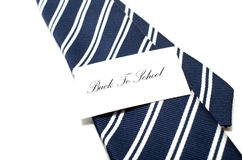 Back to school tag on blue tie Royalty Free Stock Photo