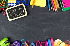 Back to School tag with school supplies border on blackboard Royalty Free Stock Image