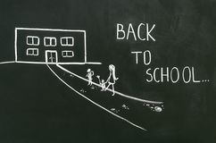 Back to school. The teacher wrote on the board back to school Stock Image
