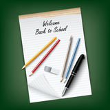 Back to School with a tear notebook and supplies Royalty Free Stock Photos