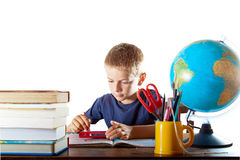 Back to school with technology. A little boy finishes off his summer homework on his tablet computer. Education and technology concept Royalty Free Stock Photos