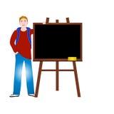 Back to school. Teenager or university student standing near empty blackboard Royalty Free Stock Image