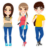 Back to School Teenagers. Three young teenagers smiling happy together standing ready to go back to school with backpacks and notebook Royalty Free Stock Photography