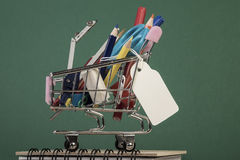 Back to school template with multiple stationery in shopping trolley Stock Images