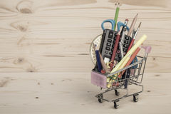 Back to school template with multiple stationery in shopping trolley Royalty Free Stock Photo