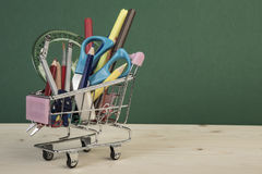 Back to school template with multiple stationery in shopping trolley Stock Photo
