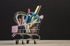 Back to school template with multiple stationery in trolley Royalty Free Stock Photography