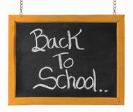 Back to school text on blackboard Stock Photo