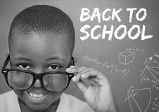 Back to school text on blackboard with boy Stock Photos