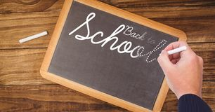 Back to school text on blackboard with chalk Royalty Free Stock Photo