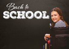 Back to school text on blackboard with disabled girl in wheelchair. Digital composite of Back to school text on blackboard with disabled girl in wheelchair Stock Photo