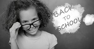 Back to school text on blackboard with girl. Digital composite of back to school text on blackboard with girl Royalty Free Stock Photo