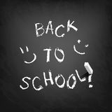 Back to school text on blackboard. Stock Photos