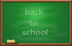 Back to school text on the blackboard Stock Images