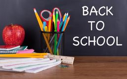 BACK TO SCHOOL Text on a Blackboard Stock Photo