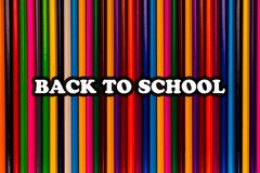 Back to school text on bright Colorful pencils royalty free stock images
