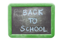 Back to school text on chalkboard. Isolated on white background Royalty Free Stock Photo