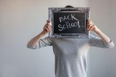 Back to school, Text on chalkboard in a vintage frame stock image