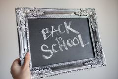 Back to school, Text on chalkboard in a vintage frame stock photos