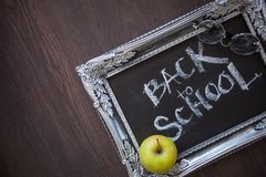 Back to school, Text on chalkboard in a vintage frame. stock photography