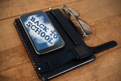 Composite image of back to school text on green and blue splash Stock Photography